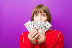 Lady with cash covering her face