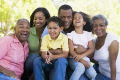 Family smiling looking at camera
